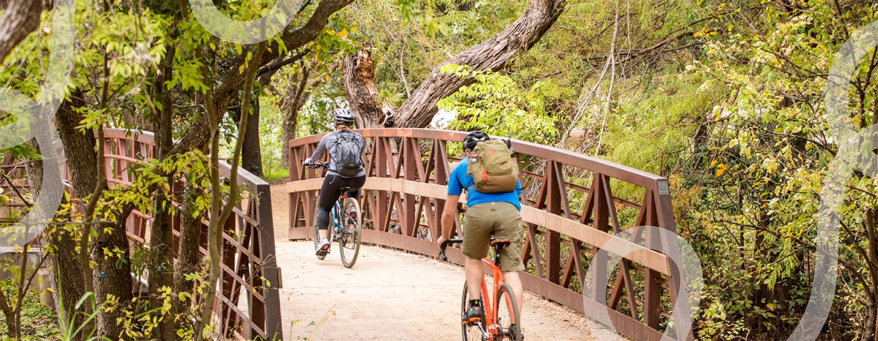 edited graphic showing people riding their bicycles over a bridge with lush greenery surrounding the area