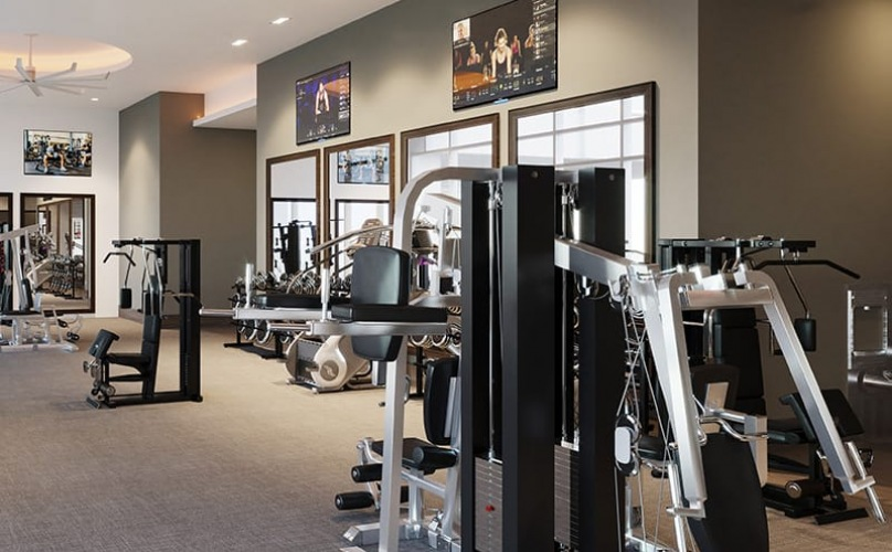 fitness center with workout equipment and water fountains in a large room