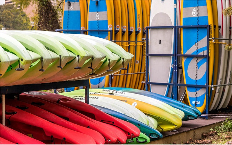 lifestyle image of stacks of canoes